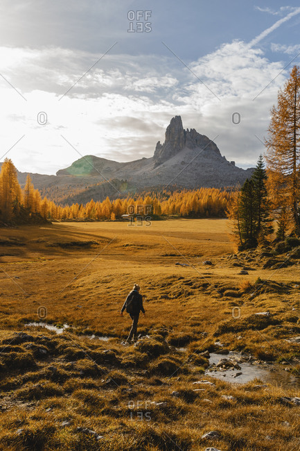 Female hiker hiking at Dolomites Alps- Cortina- Italy