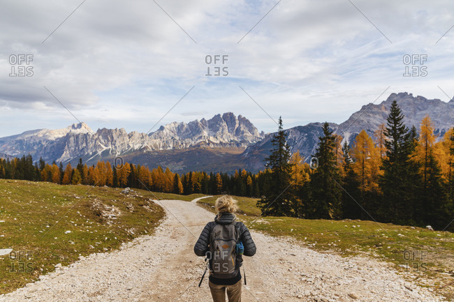 Rear view of female hiker hiking at Dolomites Alps- Cortina- Italy