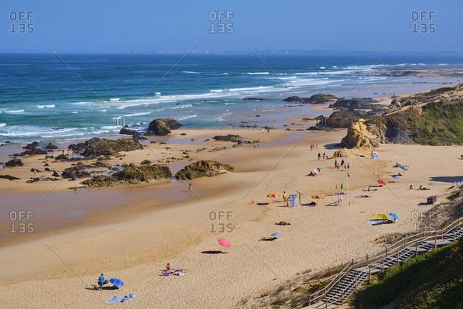 Portugal- Alentejo- Vila Nova de Milfontes- People relaxing on Malhao beach in summer