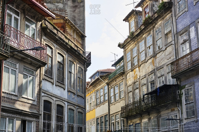 Portugal- Porto- Windows and balconies of old residential buildings