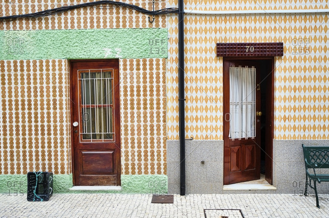 Portugal- Porto- Afurada- Two traditional house facades seen during daytime