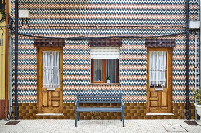 Portugal- Porto- Afurada- Unique ornate house facade seen from pavement