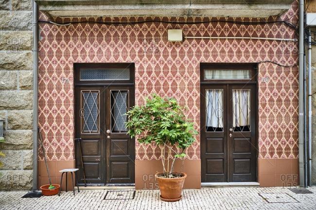 Portugal- Porto- Afurada- Front view of unique ornate house facade