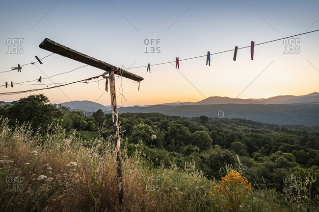 Old clotheshorse with clothespins at sunset- Zonza- Corsica- France