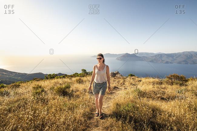 Female hiker during hike- Belvedere de Saliccio- Piana- Corse-du-Sud- Corsica- France
