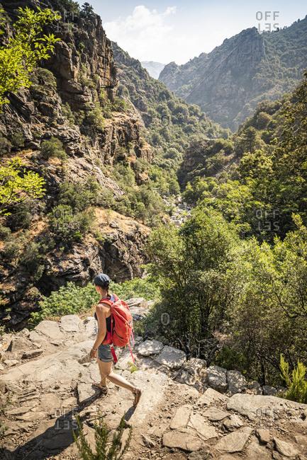 Female hiker during hike- Gorges de Spelunca- Ota- Corse-du-Sud- Corsica- France