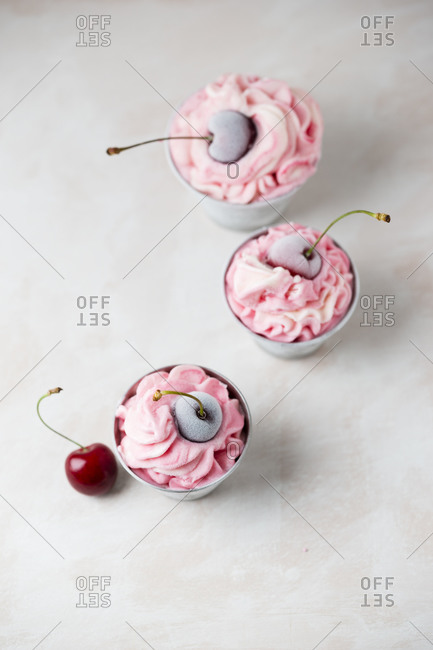High angle view of cherry ice creams served in bowls on table