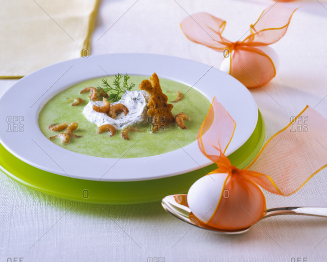 Pea soup with North Sea crabs and sour cream in plate during Easter