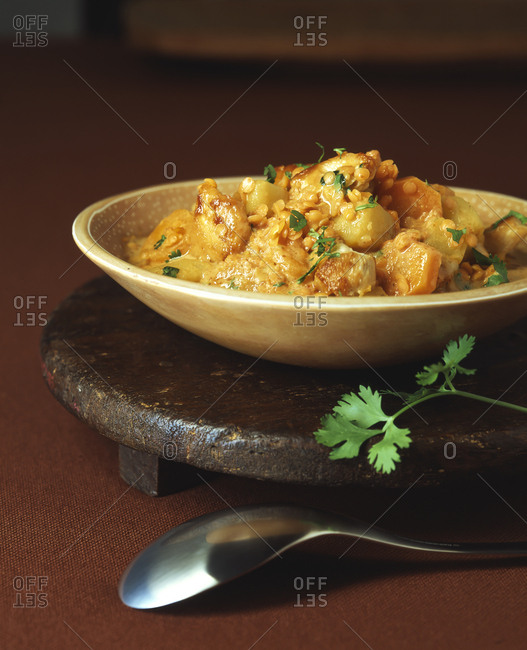 Close-up of chicken curry with potatoes served in bowl on table