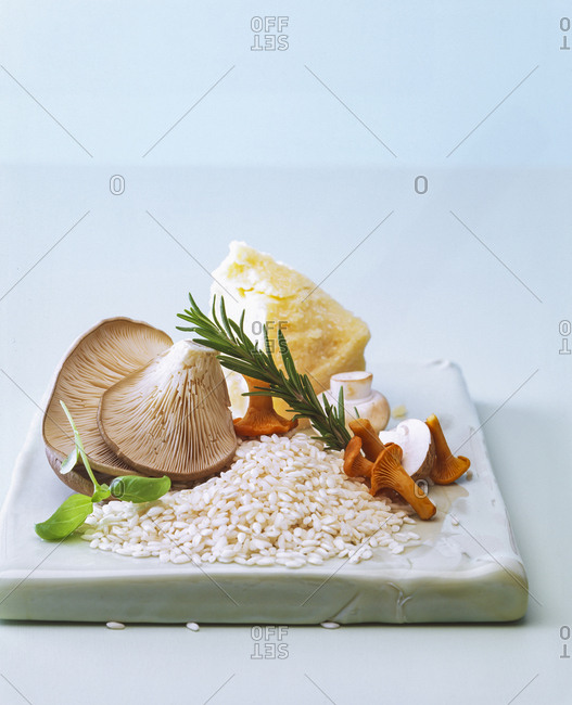 Close-up of raw ingredients for cooking Risotto on table against wall
