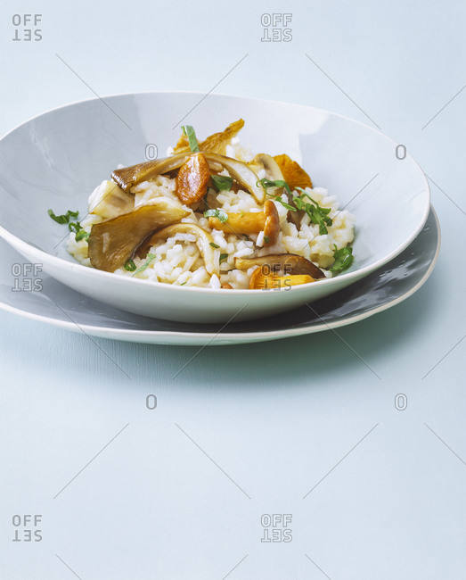 Close-up of risotto with mushrooms served in bowl on table