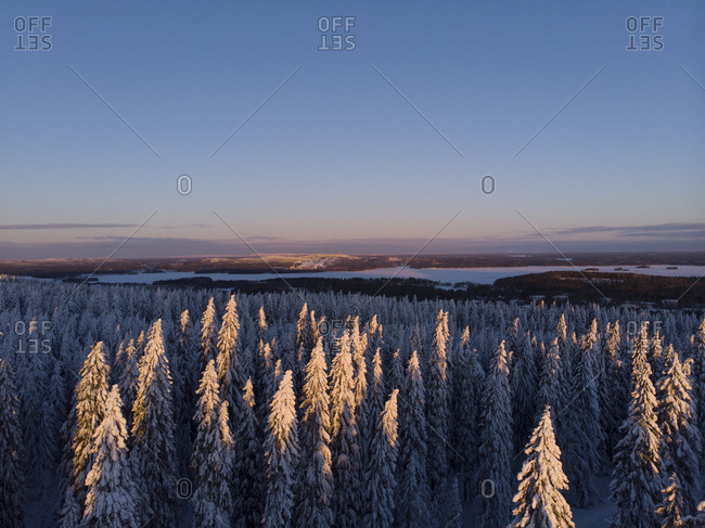 Finland- Kuopio- aerial view of winter landscape at sunset