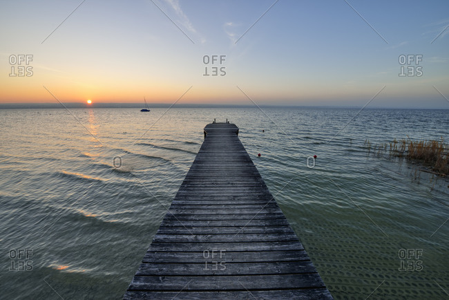Sunset on wooden jetty over lake Ammersee Bavaria- Germany