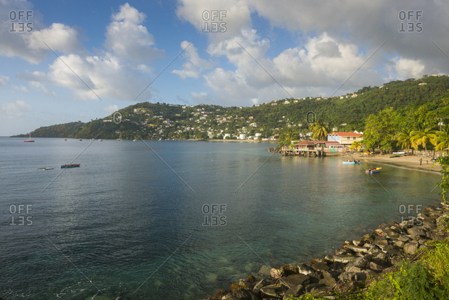 View of Grand Mal Bay by mountain against cloudy sky- Grenada- Caribbean