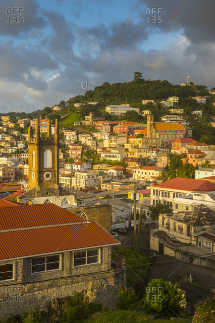 Aerial view of buildings in St. George's town against cloudy sky at sunset- Grenada- Caribbean