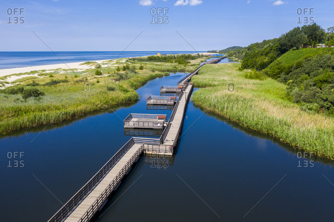 Aerial view of boardwalk amidst lake on coast of Yantarny- Kaliningrad- Russia