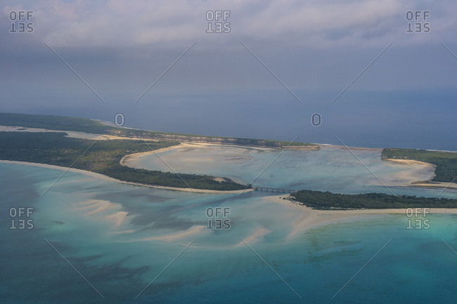 Aerial view of Ouvea- against cloudy sky at Loyalty Islands- New Caledonia