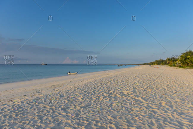 White sand beach at sunset against sky in Ouvea- Loyalty Islands- New Caledonia