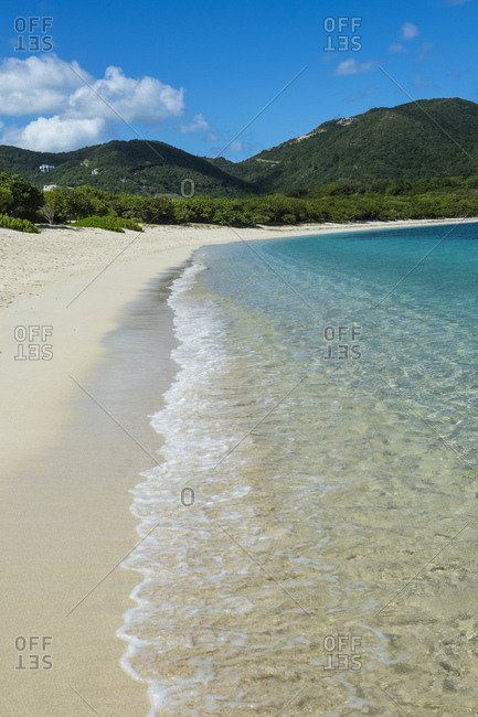 Scenic view of Long bay beach against blue sky during sunny day- Beef island- British Virgin Islands
