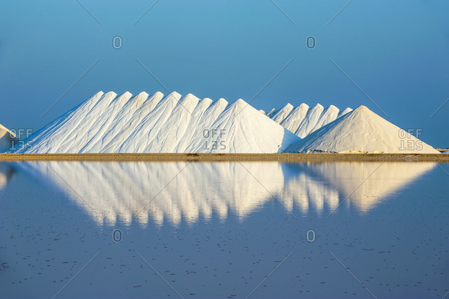 Salt flat against clear blue sky during sunny day- Bonaire- Caribbean Netherlands