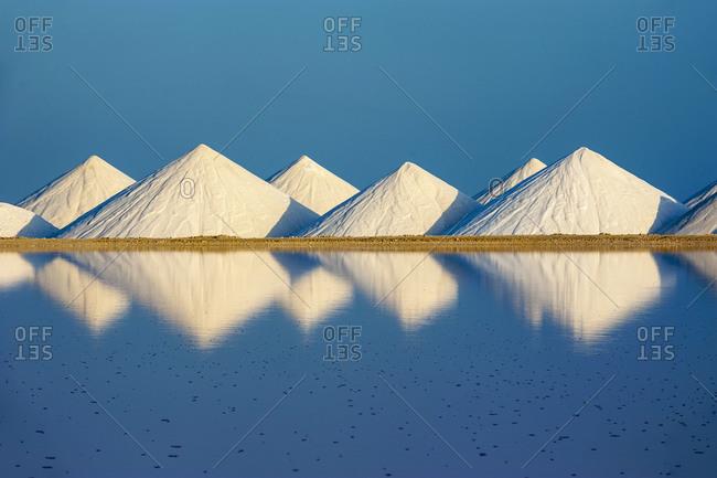 Salt flat against clear blue sky on sunny day- Bonaire- Caribbean Netherlands