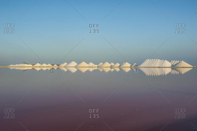 Salt lake against clear blue sky at sunset- Bonaire- Caribbean Netherlands