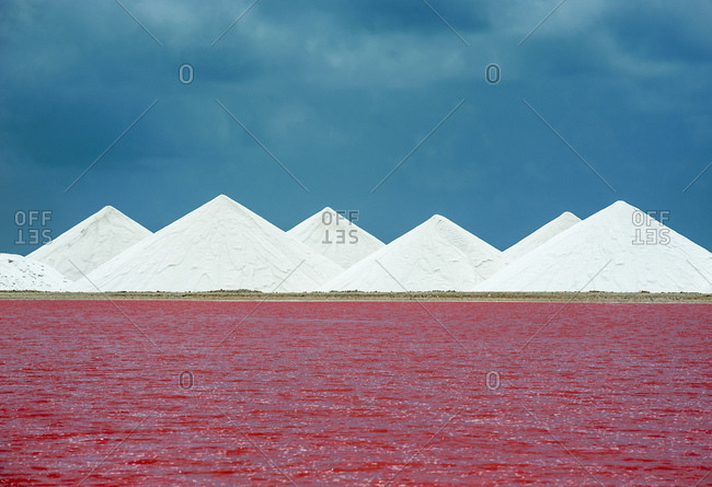 View of red salt lake against blue sky at Bonaire- Caribbean Netherlands