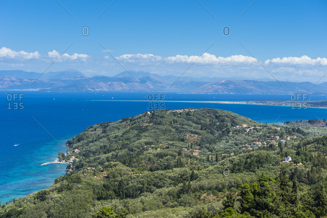 Aerial view of coastline against blue sky during sunny day- Corfu- Ionian islands- Greece