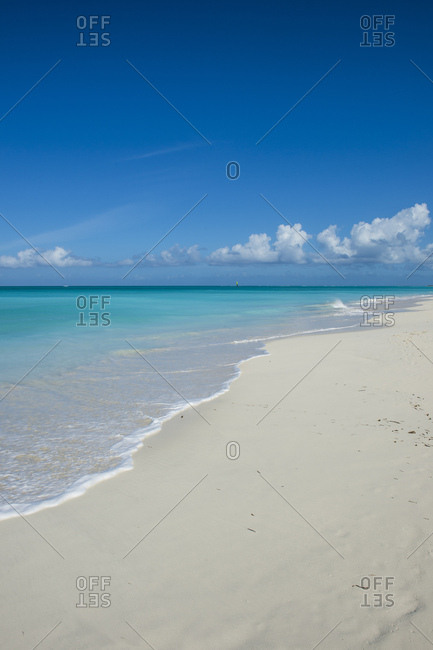 Scenic view of Grace Bay beach against blue sky- Providenciales- Turks And Caicos Islands