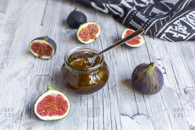 Sliced figs and jar of homemade fig jam