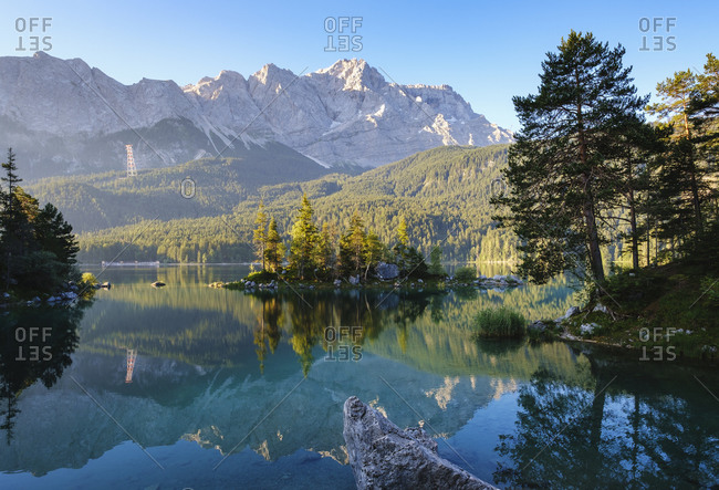 Scenic view of Eibsee lake Braxen island and Zugspitze in background- Werdenfelser Land- Upper Bavaria- Bavaria- Germany