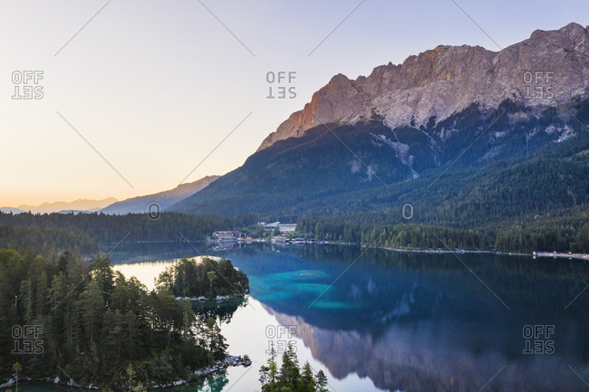Scenic view of Eibsee lake with Eibsee Hotel in background against Wetterstein Mountains- Grainau- Werdenfelser Land- Upper Bavaria- Bavaria- Germany
