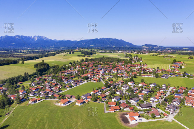 Aerial view of Greiling against clear sky with Benediktenwand and Blomberg mountains in background- Tyler Land- Upper Bavaria- Bavaria- Germany