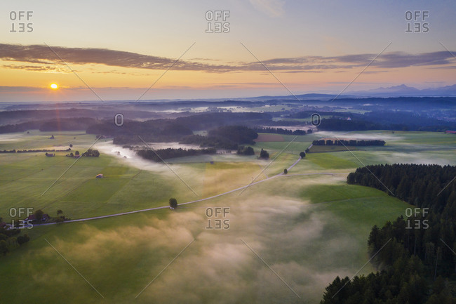 Scenic view of landscape against sky during sunrise at Dietramszell- Tyler Land- Upper Bavaria- Bavaria- Germany