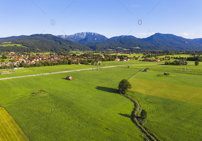 Scenic view of landscape at Bichl with Benediktenwand and Rabenkopf mountains in background- Tyler Land- Upper Bavaria- Bavaria- Germany