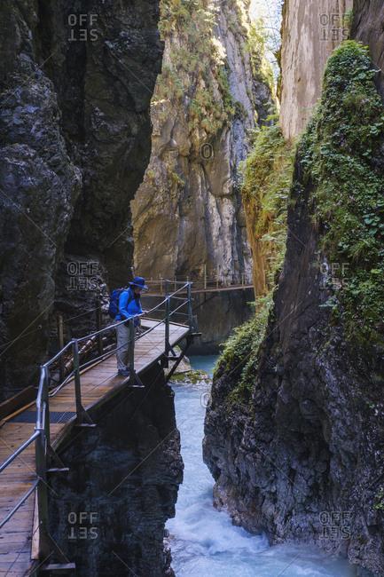 Senior woman at Wasserfallsteig in Leutasch Gorge- Tyrol- Austria