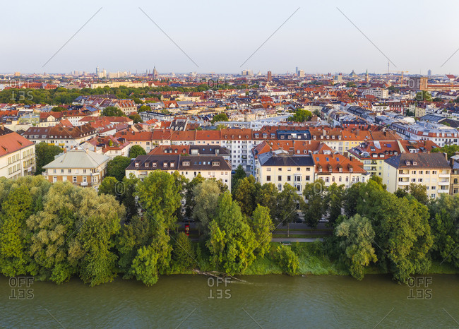 Germany- Upper Bavaria- Munich- Trees along Isar river with city buildings in background