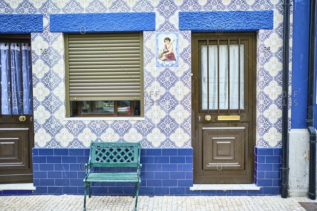 September 18, 2019: Portugal- Porto- Afurada- Unique blue house facade seen during day