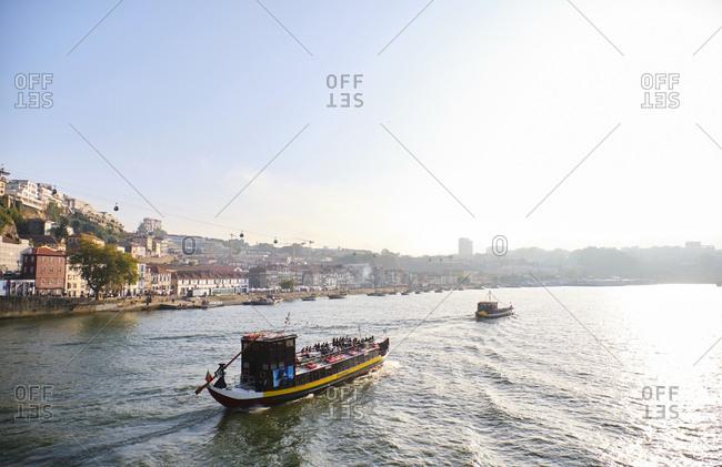 September 18, 2019: Portugal- Porto- Vila Nova de Gaia- Rabelo boats transporting wine along Douro river