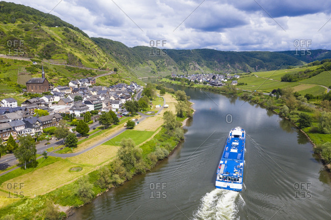 June 11, 2019: Aerial view of cruise ship on Mosel River against cloudy sky near Cochem- Germany