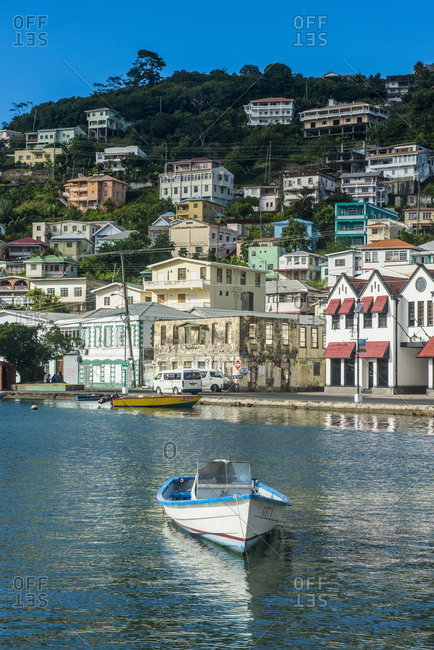 January 3, 2015: White motorboat moored at harbor of St Georges- capital of Grenada- Caribbean