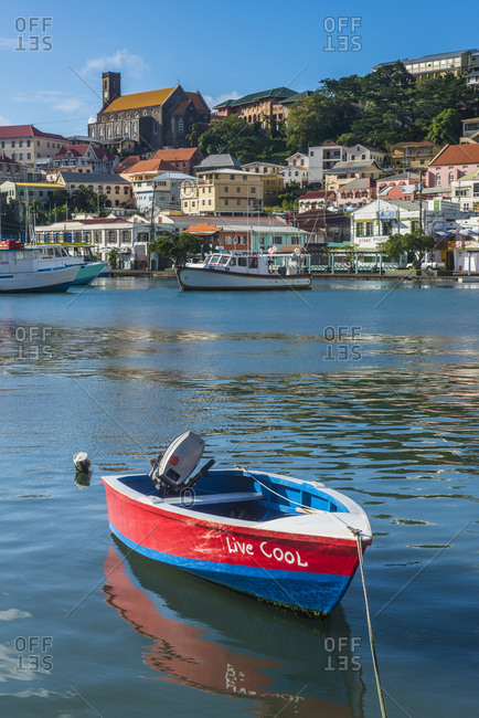 January 3, 2015: Motorboat moored in harbor of St Georges- capital of Grenada- Caribbean