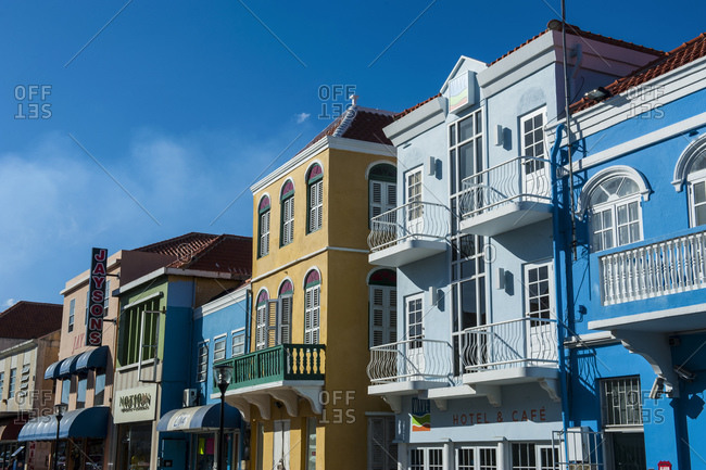 September 2, 2011: Low angle view of colorful buildings against blue sky in Willemstad during sunny day- CuraÁao