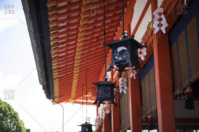 Japan- Kyoto Prefecture- Kyoto City- Lanterns hanging under canopy of Fushimi Inari-taisha temple