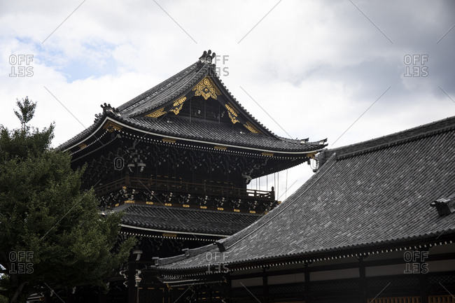 Japan- Kyoto Prefecture- Kyoto City- Black tiled roofs of Buddhist temple