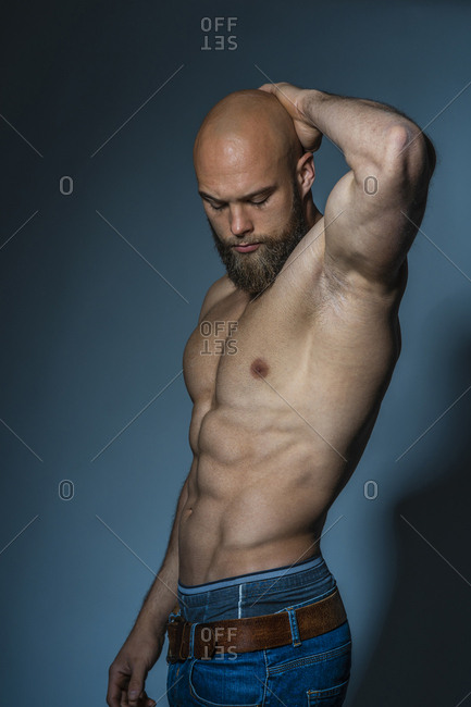 Portrait of a barechested athlete in studio