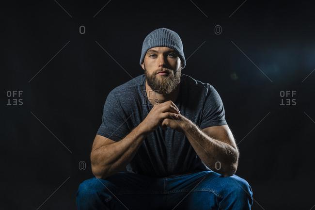Portrait of a muscular man sitting in studio