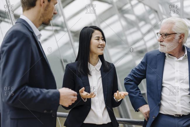 Business people talking in modern office building