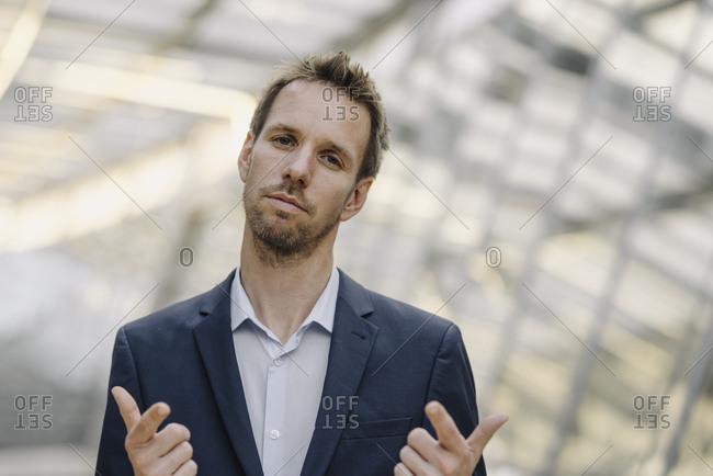 Portrait of self-confident businessman - Offset