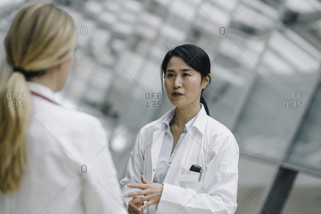 Female doctor talking to a colleague